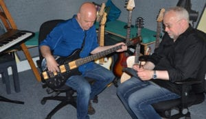 working on music to lyrics at offbeat studios